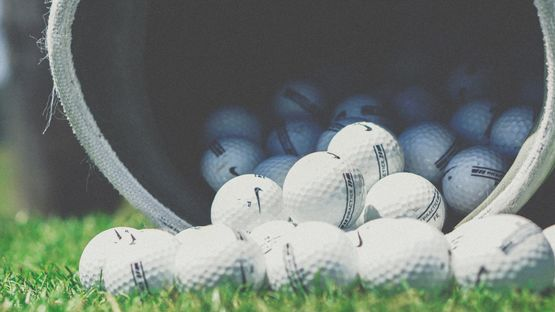 A large amount of golf balls